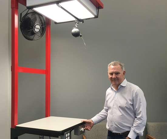 Don Dumoulin, CEO of Precise Tooling Solutions, demonstrates one of three varieties of Ergosmart worktables, a profitable new business that doesn't interfere with core mold-making and machining work.