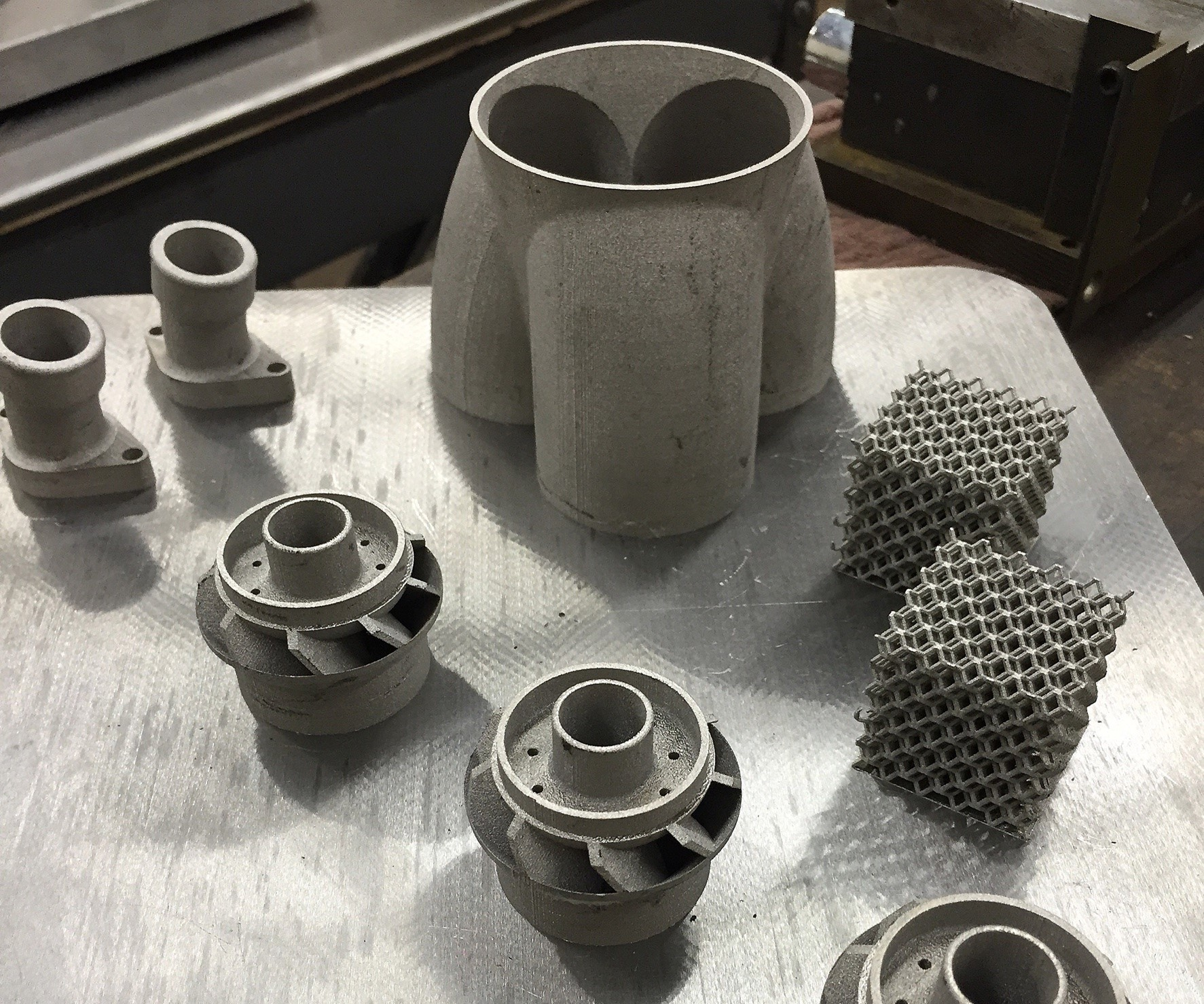 Metal 3D-printed pipe fittings, swirlers, lattice cubes and exhaust manifold