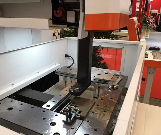 The workzone of a wire-type EDM machine from Suzhouhanqi