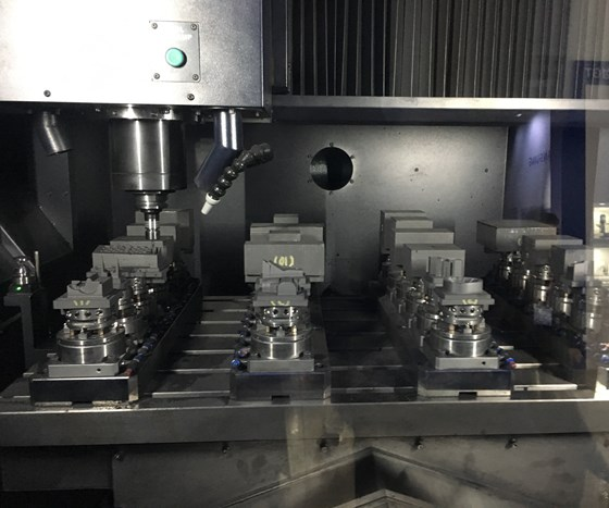 A line of graphite electrodes undergoes machining with automated CAM programming within the workzone of Hwacheon's
