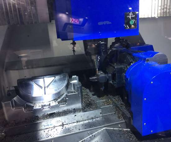 The wrokzone of Hwacheon's Smart Core machine features space to perform three-axis routines on one side and 3+2 routines on work mounted on a rotary table on the other side.