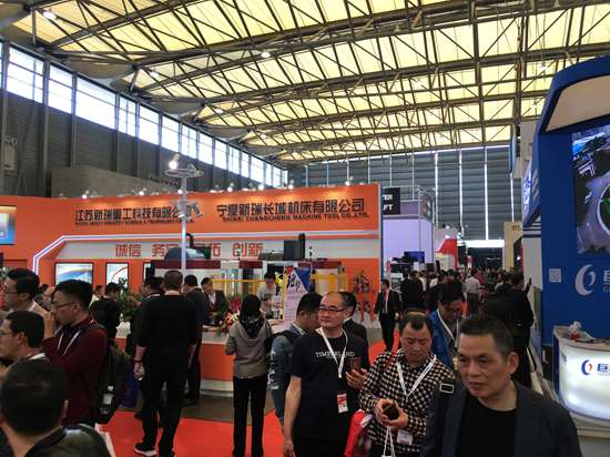 Crowds gather in and among booths at the CCMT show in Shanghai, China.