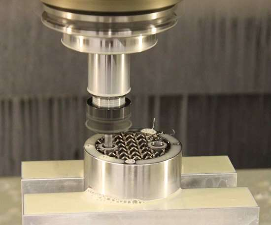 metal additive manufacturing part being machined to meet tolerances