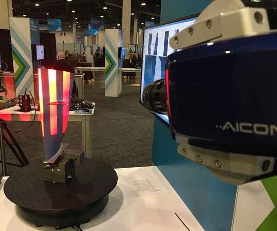 The Aicon Stereoscan Neo uses structured light light to digitize a curved part surface.