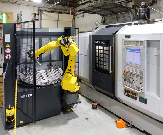 Pairing a robot arm with turntable for staging workpieces, this machine-tending automation system is designed to be easy to set up, program and move between machines.