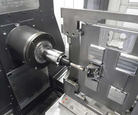 A view of the workzone of a horizontal machining center demonstrates the contrast between this configuration and that of a vertical machining center.