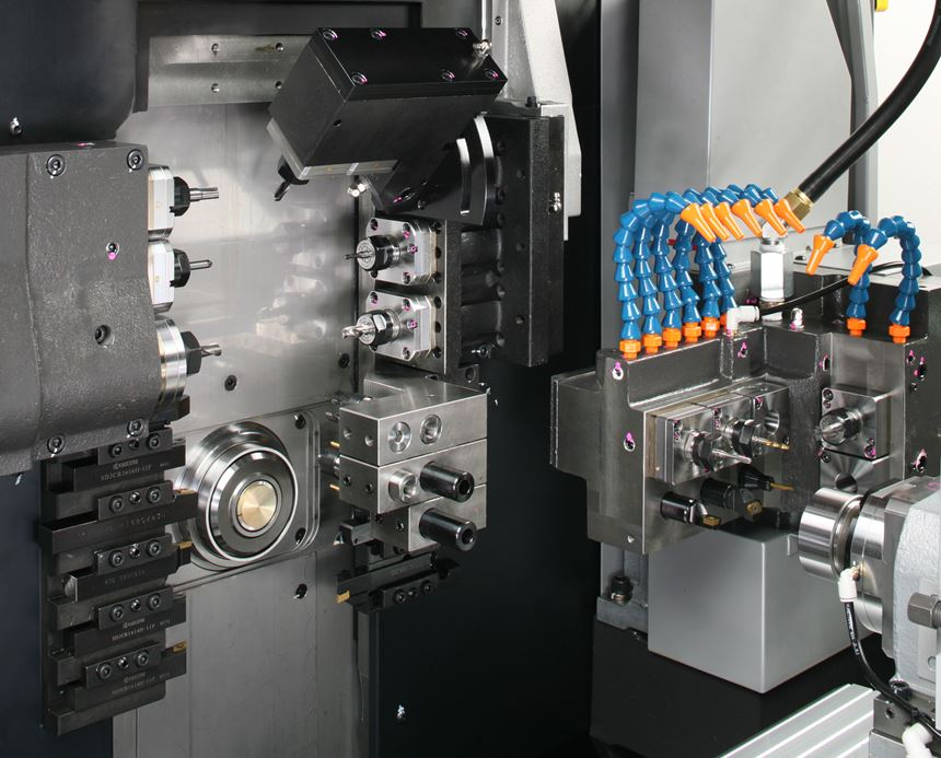 Main spindle, subspindle and various tool posts are visible within the workzone of this Swiss-type lathe, a machine designed to machine parts complete in one setup.