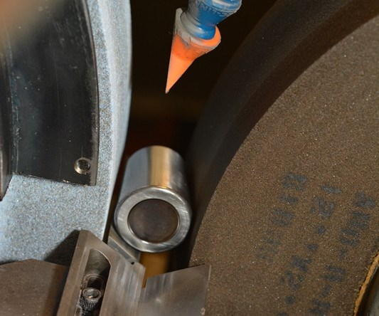 grinding a tapered roller