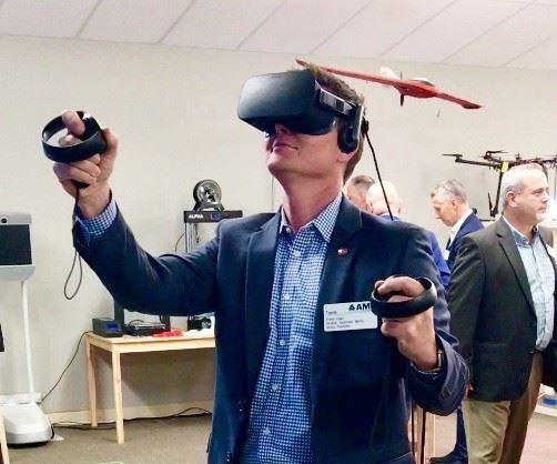 Travis Egan experiences augmented reality.