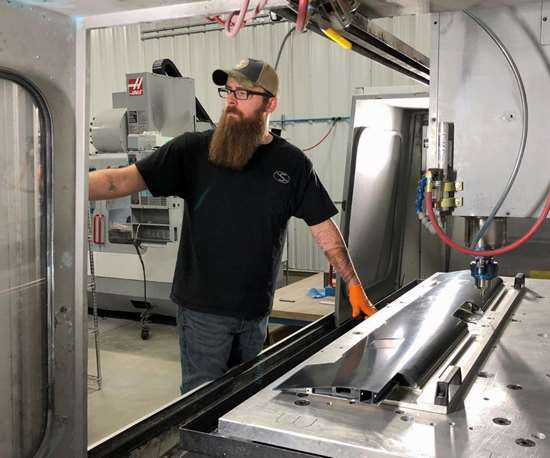Carbon fiber trimming with a Haas VF 6 CNC machining center at Flying S