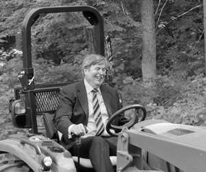 Mitsui Seiki's Scott Walker on a tractor