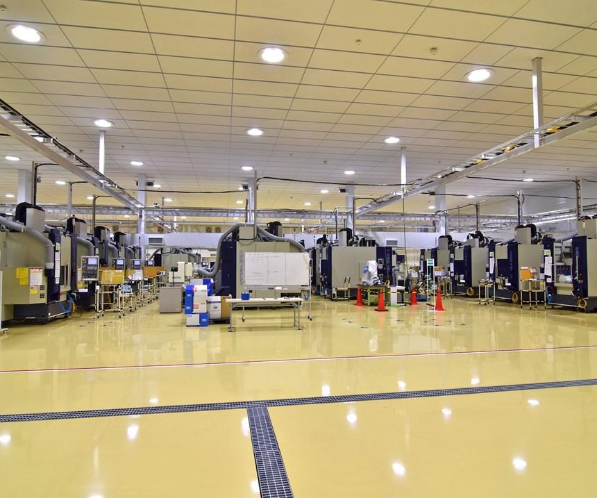 AeroEdge factory floor with rows of Mitsui Seiki Vertex 55-II VMCs