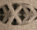 partially melted powder particles in a Ti-6Al-4V lattice structure