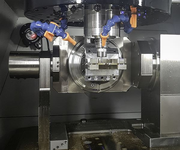 High-End Watchmaker Eliminates Offshoring with Five-Axis Machining Center image