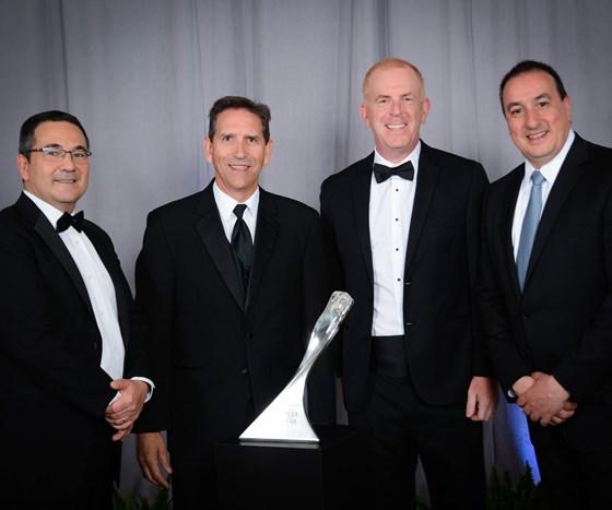 Barnes International representatives receive GM award