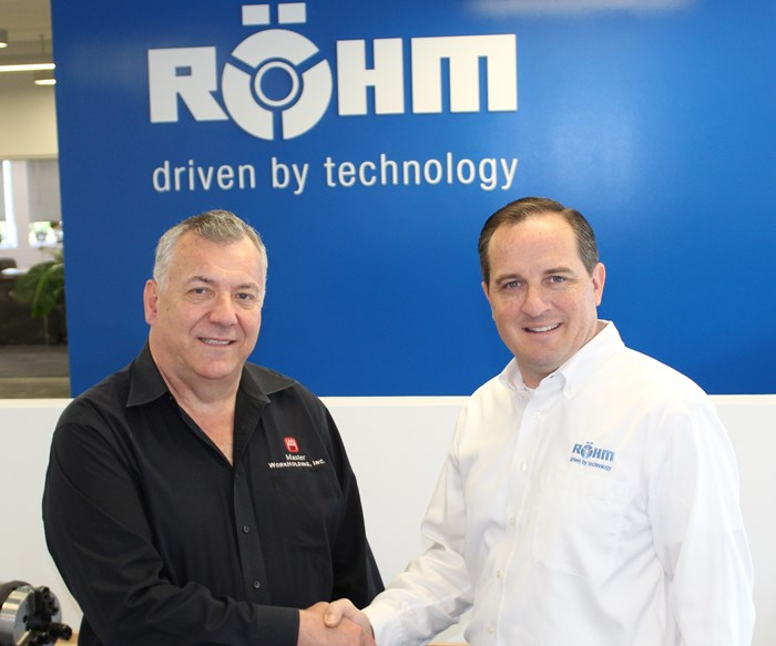 Representatives from Rohm and Master WorkHolding shaking hands