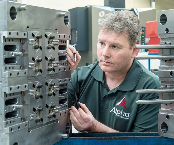 Brendan Feely of Alpha Precision checks an injection mold