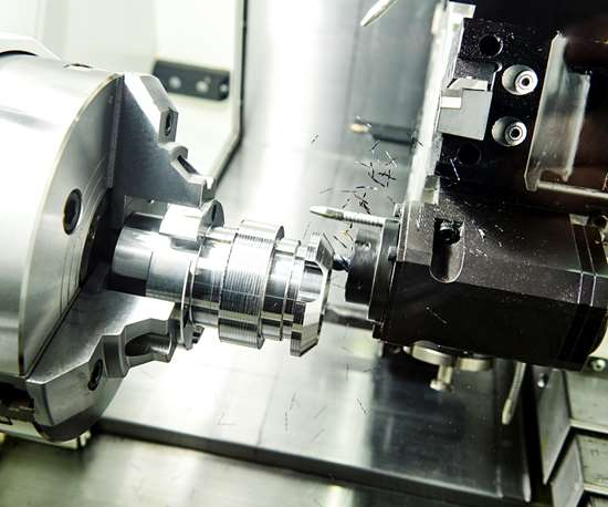 photo of a driven tool milling a feature on a turned part