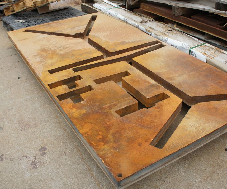 The waterjet has already machined a large manifold from this piece of steel, the top and bottom portions of which were Blanchard-ground for flatness beforehand. The extra material will sit behind the shop until an opportunity arises to cut other parts from the same plate.