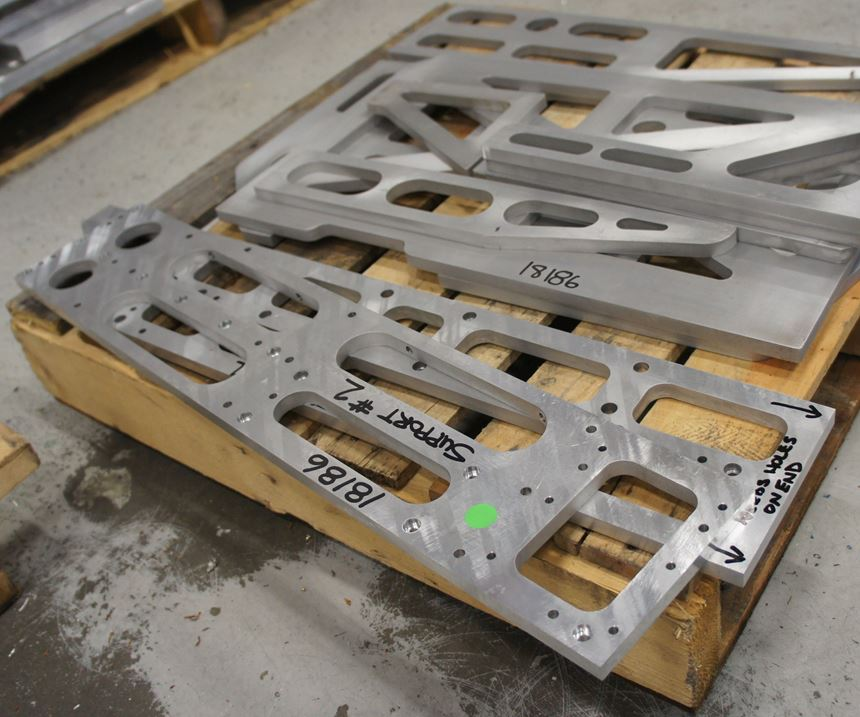 Examples of parts cut on IMC's waterjet. Some of these waterjet parts have also undergone  milling for 3D features like countersunk holes. The shop is experimenting with pneumatic drilling and reaming heads that could further expand the waterjet's capabilities.