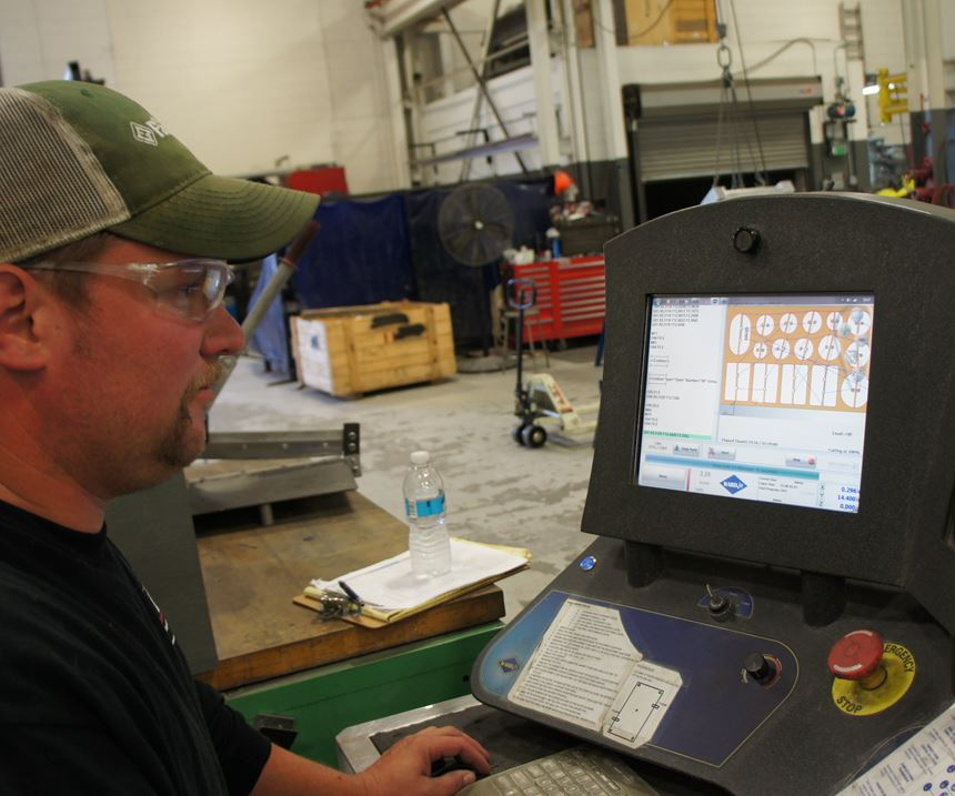 Aaron Bazydlo, the waterjet's primary operator, demonstrates how the system's software eases the work of locating and aligning multiple parts on the table.