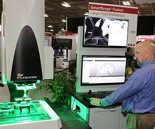 QVI employee demonstrating on the Fusion 400 system