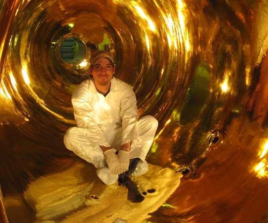 man sitting in a bell jar