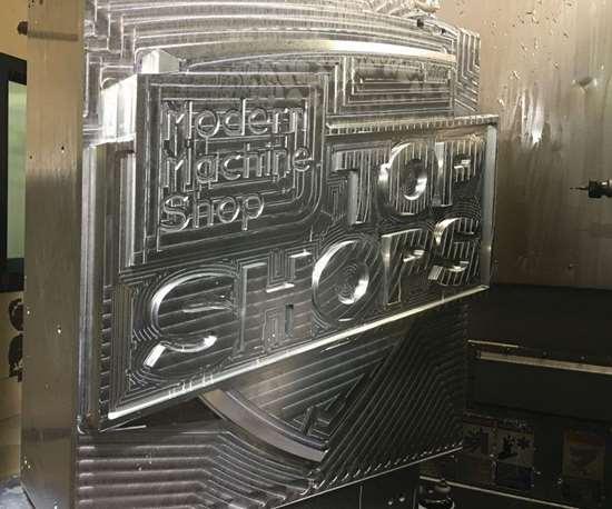 top shops benchmarking machined logo