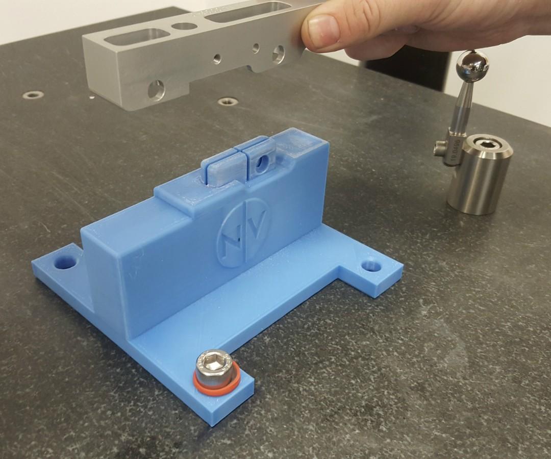 Bearing block held above the 3D-printed CMM fixture