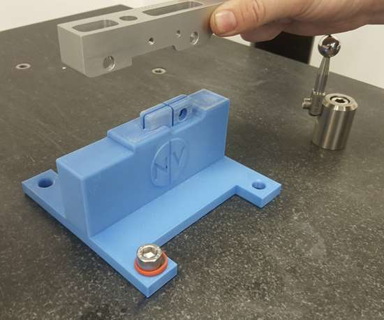 Bearing block held above the 3D-printed CMM fixture