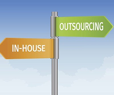 decision sign about manufacturing in house or outsourcing