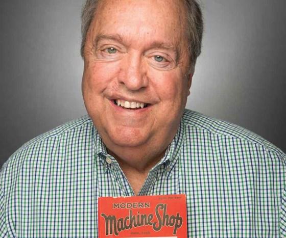 Richard G Kline holding the first issue of Modern Machine Shop