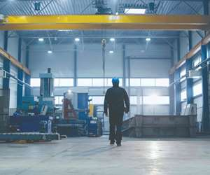 man walking away on a manufacturing shop floor