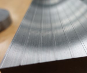 metal workpiece machined by surface grinding showing chatter on some passes