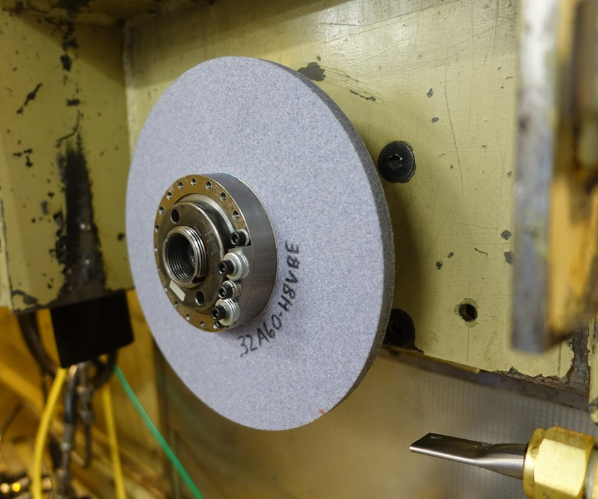 Imbalance added to grinding wheel for vibration research
