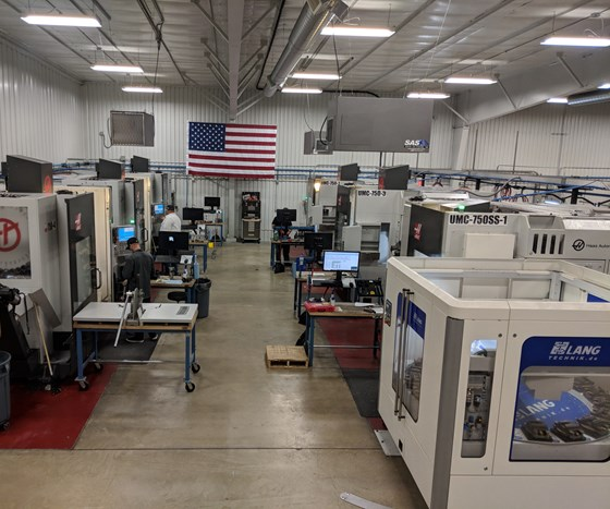 Cell of UMC-750SS five-axis machines, one with a Lang pallet changer