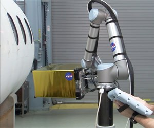 A cobot performs an infrared inspection program on an airplane fuselage