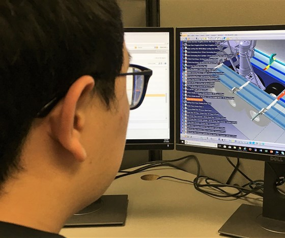 An engineer looks at part data using Navigate