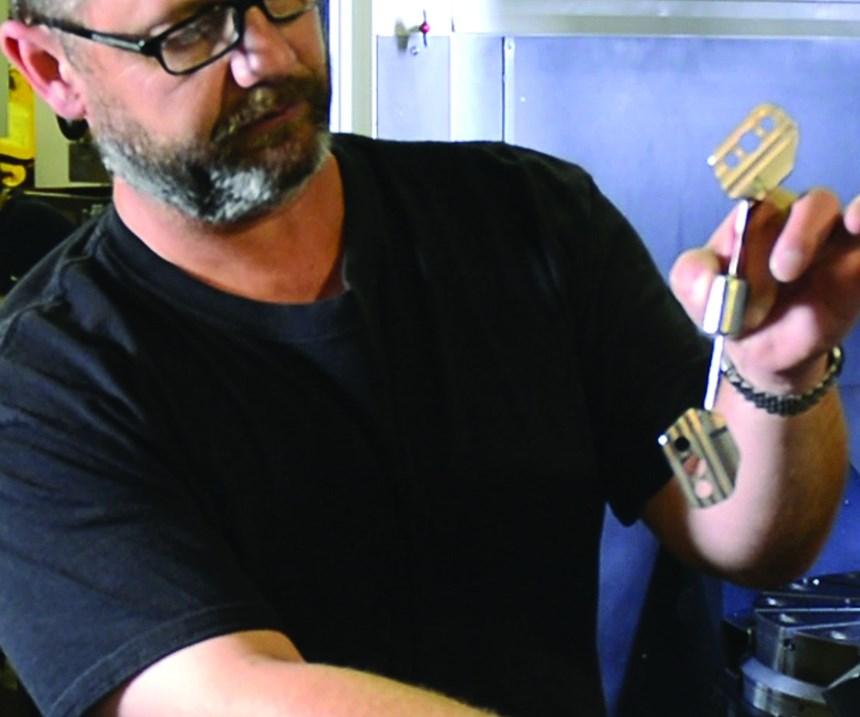 Mike Jezowski holds a camera mounting bracket