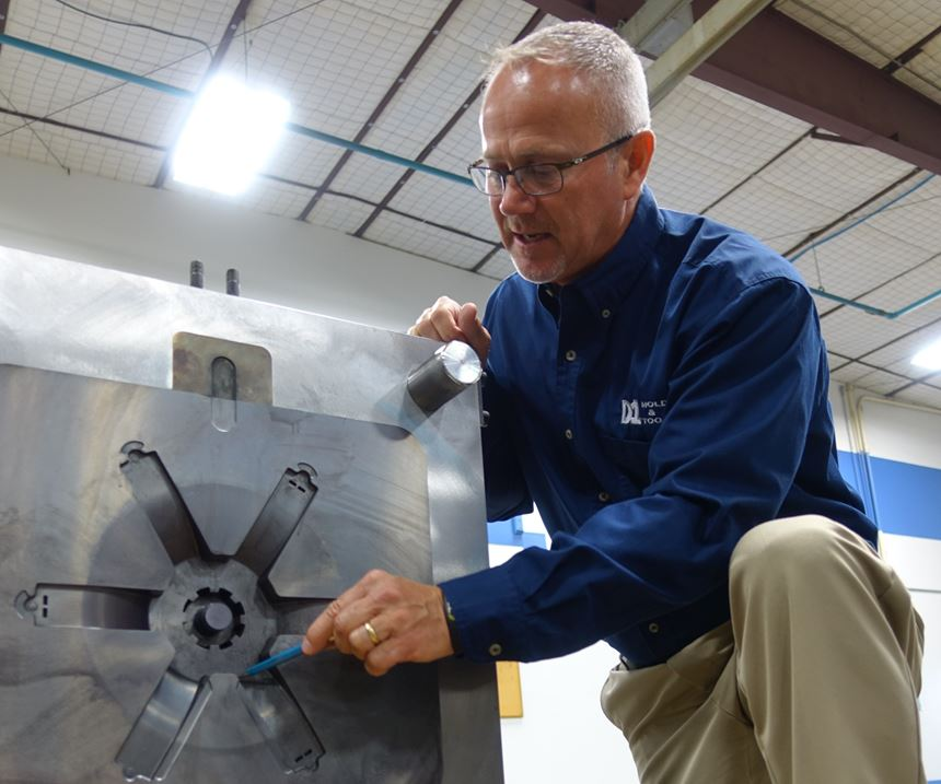Tony Dungan with a die for a washing machine component