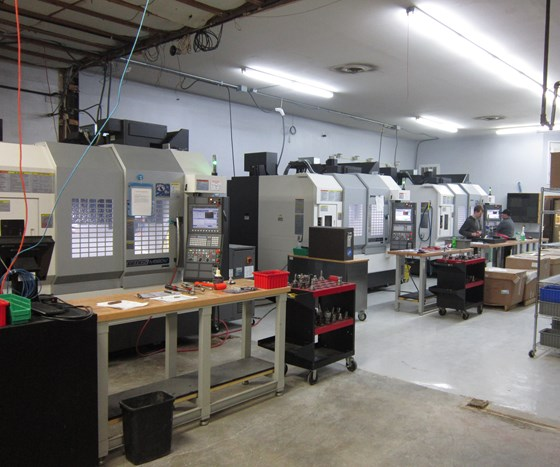 Three of GCG's Okuma Genos M560-V VMCs