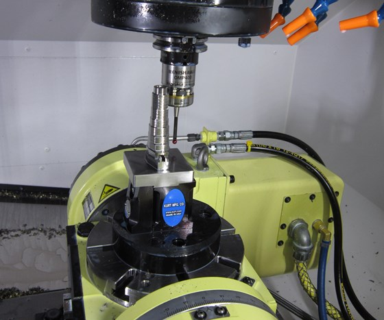 A touch-trigger probe from Renishaw probes a part on a rotary table