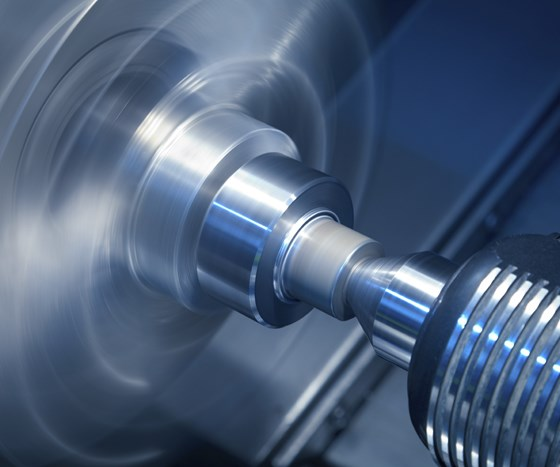 photo of a lathe spinning a part