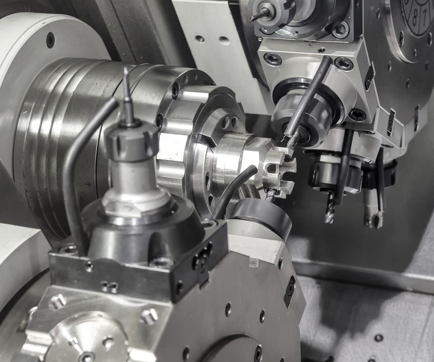 a turning machine with two turrets applying driven milling tools to a part