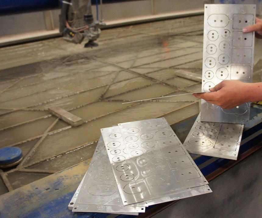 Mr. Bazydlo separates shims cut simultaneously on the waterjet.