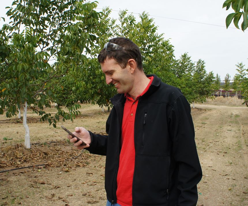 Text and ringtone alerts from CNC machine tools to his mobile phone keep Mr. Wentzel informed of what's happening at the shop as he strolls through his walnut orchard. 