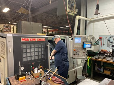 Tom Foulke, machinist at aerospace job shop McMellon Bros., sets up parts in one of the company's DMG/MORI twin-spindle CNC turning centers.