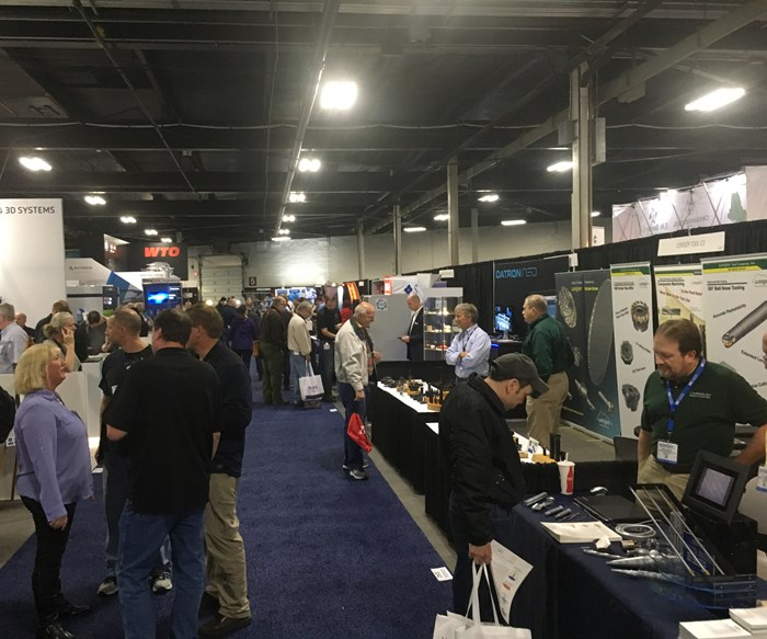 Attendees navigate various booths at Eastec 2019.