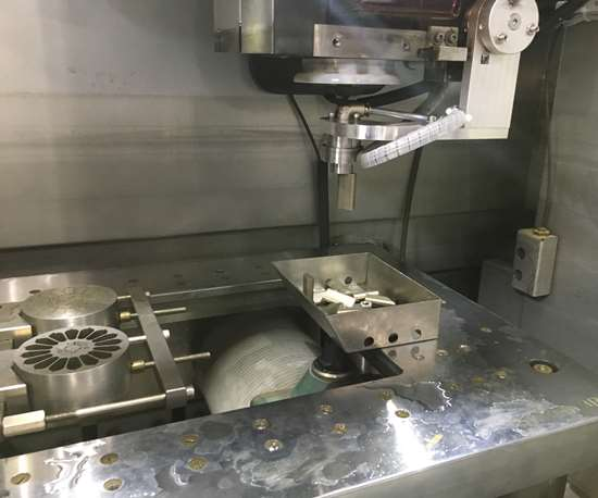 The automatic slug removal system pulls a cut piece of metal from the workpiece on an AgieCharmilles Cut P 350 EDM from GF Machining Solutions.
