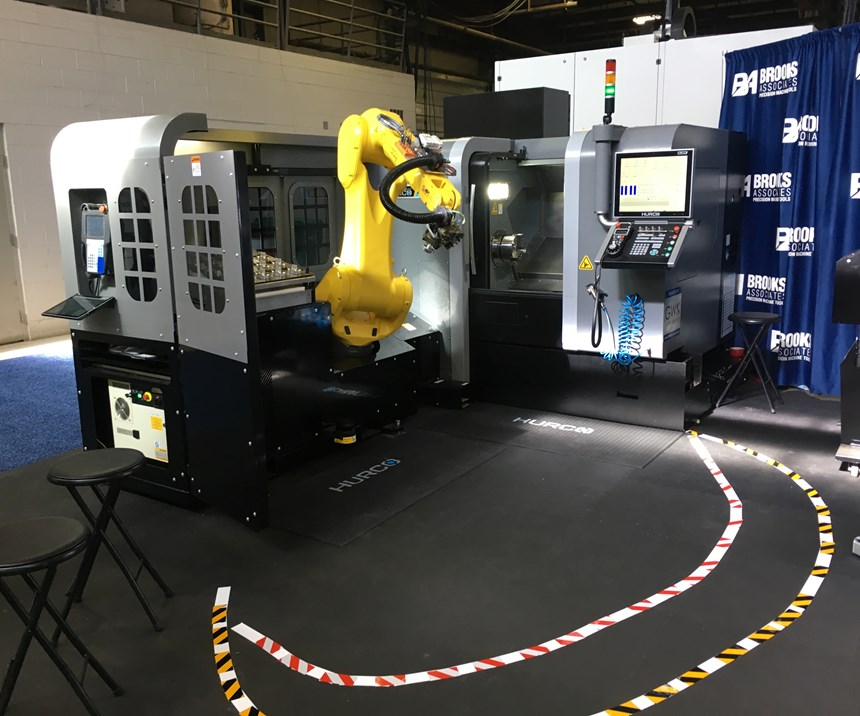 Hurco displays two machine tools tended by a robot arm that uses a light curtain to slow, and eventually stop, when humans get too close.